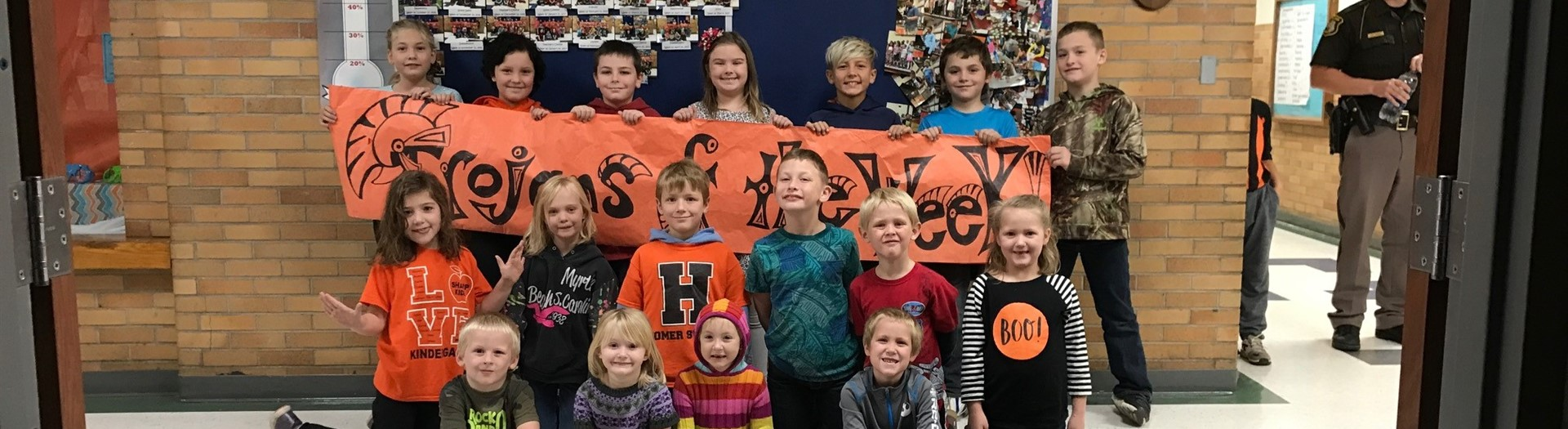 "Elementary students in three rows to be recognized as ""Trojans of the Week"""